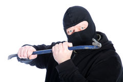 Masked robber wielding a crowbar Stock Photography