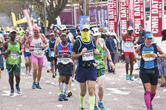 Masked Runner Competing in Comrades Ultra Marathon Stock Images