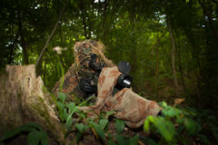 Masked sniper. Is aiming at the target Royalty Free Stock Photo