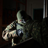 Masked sniper is aiming at the target during the mission Stock Photo