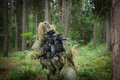 Masked soldier. Is aiming at the target royalty free stock photography