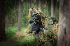 Masked soldier. Is aiming at the target (focused on the barrel stock photography
