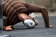 Masked street performer. AURILLAC, FRANCE - AUGUST 24: masked dancer in the street as part of the Aurillac International Street Theater Festival,show by the Stock Photos