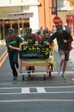 Masked Team Races A Bed In Quirky Fundraiser Race Stock Images