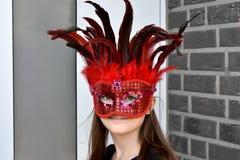 Masked teenage girl stock image