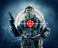 Masked terrorist man with gun and laser target on his body Royalty Free Stock Photos