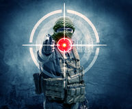 Masked terrorist man with gun and laser target on his body Stock Image