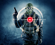 Masked terrorist man with gun and laser target on his body Royalty Free Stock Image