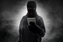 Masked thief angry on smoke background stock photography