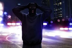Masked thief caught by police Stock Photo