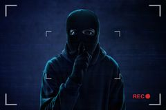 Masked thief caught on security camera Royalty Free Stock Image