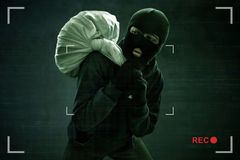 Masked thief caught on security camera Royalty Free Stock Images
