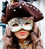Masked Venitian manakin. Masked female Venetian manakin wearing a pirate style hat. Commonly used for venetian carnival celebrations Stock Photography