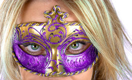 Masked woman Stock Images