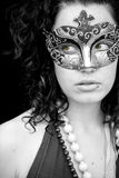 Masked woman. Masked curly woman in monochrome with amazing green eyes Stock Image