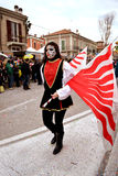 Masked woman in carnival in Fano. Masked woman with red-white flag Stock Photos