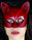Masked woman with closed eyes Stock Photo