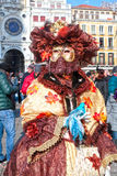 Masked woman in costume on San Marco Square, Venice, Italy. Royalty Free Stock Photos