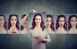 Masked young woman expressing different emotions royalty free stock photos