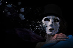 Masked woman face break apart Royalty Free Stock Photos