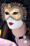 Masked woman with feathers at the Carnival of Venice Royalty Free Stock Images