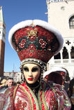 Masked woman with flashy hat at the Carnival of Venice Royalty Free Stock Photos