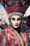 Masked woman with flashy hat at the Carnival of Venice Royalty Free Stock Photo