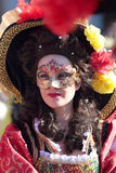 Masked woman in historical dress at Carnival of Venice Royalty Free Stock Photo
