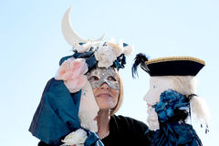 Masked Woman playing two puppets during the Carnival of Venice Stock Photo