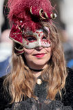 Masked woman in Venice during the Carnival Stock Images