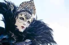 Masked woman in Venice carnival. Portrait of a carnival masked woman with plumes in color image Royalty Free Stock Image