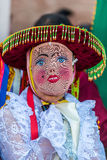 Masked woman Virgen del Carmen parade peruvian Andes Pisac Peru Royalty Free Stock Photos