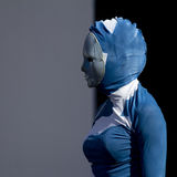 Masked woman wearing a blue suit. Stock Photography