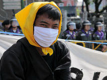 Masked Yellow-Shirt Protester Royalty Free Stock Photo