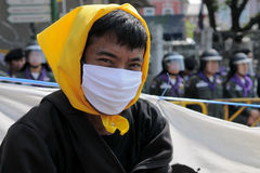 Masked Yellow-Shirt Protester Royalty Free Stock Images