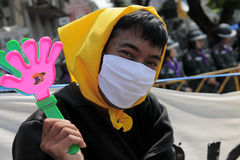 Masked Yellow-Shirt Protester Stock Photography