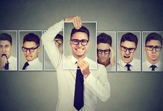 Masked young man in glasses expressing different emotions royalty free stock image