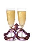 Masken- und Champagnerglas Stockfotos