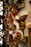 Masker op de muur Stock Foto