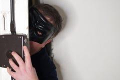 Maskerad inbrottstjuv arkivbilder