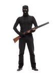 Maskerad terrorist som rymmer en hagelgevär Arkivfoto