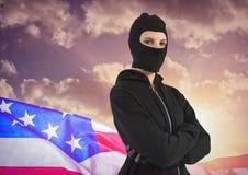 Maskerade kvinnor som står på amerikanska flaggan fotografering för bildbyråer