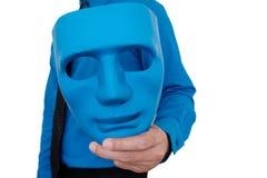 Maskering i hand Arkivfoto
