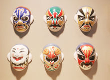 Maskeringar för ansiktsbehandling för Pekingopera Arkivbilder