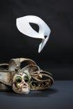 Maskers op Dark Stock Foto's