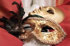 Maskers op een textiel Stock Afbeelding