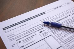 Maski, India- 20,May 2019 : Concept of filling NRC or National Register of Citizens form with pen on table.  royalty free stock photos