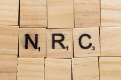 Maski, India 18, pu? 2019: Nrc o registro nazionale dei cittadini nei caratteri in grassetto di legno fotografia stock