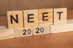 Maski Indien 26, Maj 2019: NEET eller nationella valbarhet- och ing?ngsprovRESULTAT 2020 i tr?kvarterbokst?ver fotografering för bildbyråer