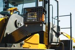 Maskin för grävskopaladdare Sidosikt av Front Hoe Loader industriellt medel Maskin för tung konstruktionsutrustning Pneumatisk la arkivfoto
